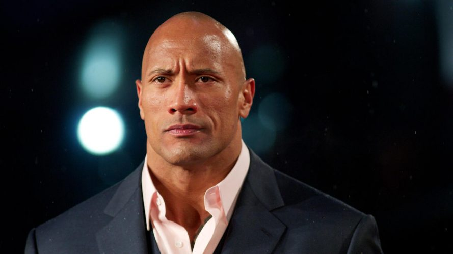 "US actor Dwayne Johnson ""The Rock"" poses for pictures on the red carpet as he arrives for the ""G I Joe: Retaliation"" UK film Premiere in central London on March 18, 2013. AFP PHOTO / ANDREW COWIE        (Photo credit should read ANDREW COWIE/AFP/Getty Images)"