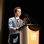 "Writer/Director Damien Chazelle speaks at Summit Entertainment's ""La La Land"" premiere at the 2016 Toronto International Film Festival on Monday, Sept. 12, 2016, in Toronto. (Photo by Eric Charbonneau/Invision for LionsgateAP Images)"