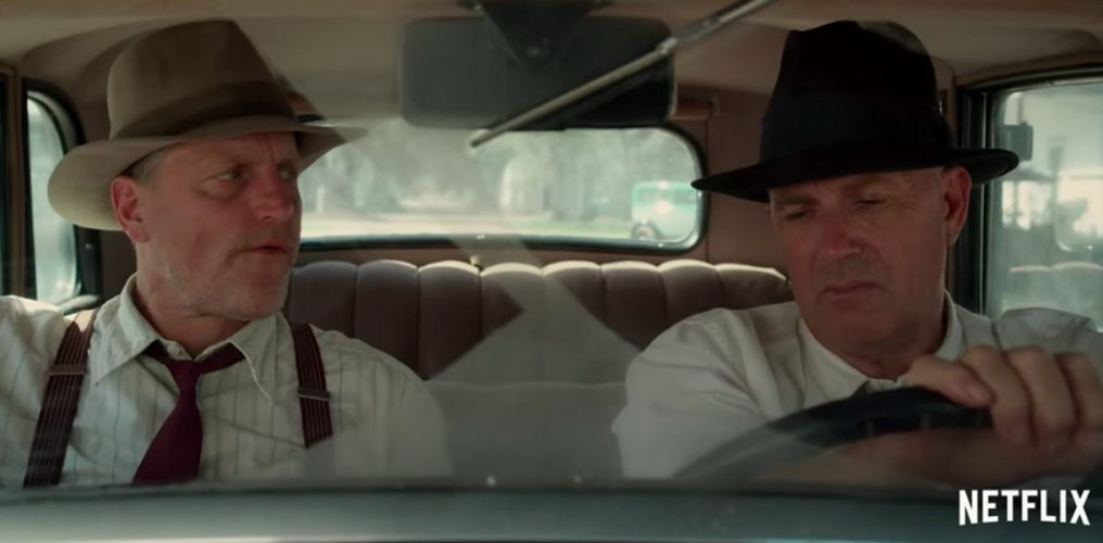 Kevin Costner and Woody Harrelson in a car